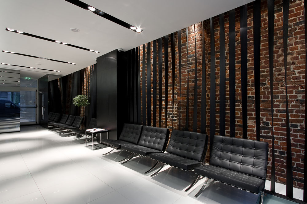Brighton Implant Clinic - Metal blades and brickwork wall in the waiting area
