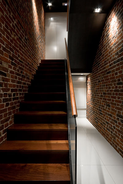 Brighton Implant Clinic - Main stairwell with existing brickwork walls