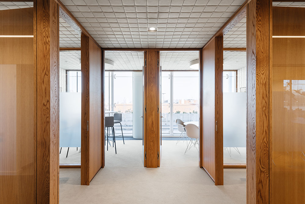 OLX Group Offices - Interior view of cluster with wooden partitions