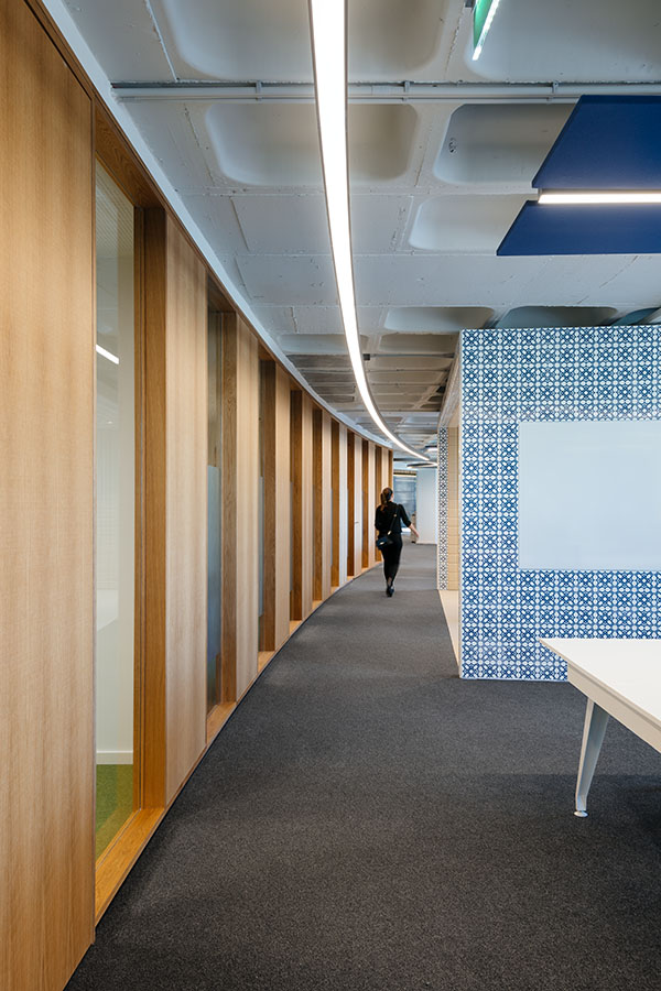 OLX Group Offices - View of main meeting room cluster with wooden partition walls