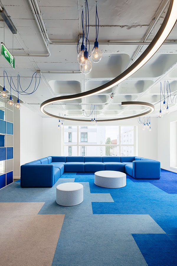 OLX Group Offices - View of blue lounge area